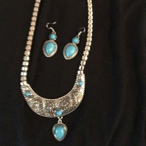 Turquoise pendant with matching earrings.